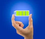 Battery full icon. Hand showing a battery full icon Royalty Free Stock Photo