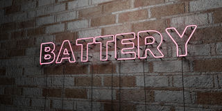 BATTERY - Glowing Neon Sign on stonework wall - 3D rendered royalty free stock illustration. Can be used for online banner ads and direct mailers Royalty Free Stock Photo