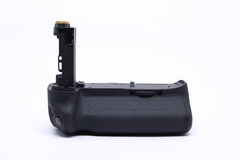 Battery grip DSLR camera. Battery grip, accessory for power energy of DSLR camera photography, isolated on white background Royalty Free Stock Images