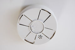 Battery Operated Smoke Detector on Ceiling Stock Photos