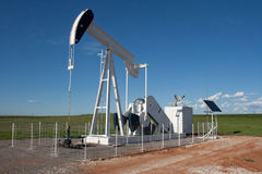 Battery Operated Well Site. Chesapeake Operating, Inc makes use of the Oklahoma wind and sunshine to power up a bank of batteries that operates and monitor this Stock Image
