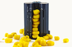 Battery pack with yellow grains of corn Royalty Free Stock Photo