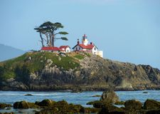 Battery Point Lighthouse on island in Pacific Ocean off Crescent City, California. Scenic, historic Battery Point Lighthouse keeps watch from an island off the Royalty Free Stock Image