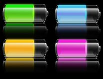 Battery power. A metaphorical illustration showing glass batteries indicating the power in them in various colors, on a black background Royalty Free Stock Image