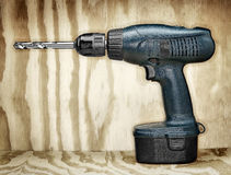 Battery Power Drill On Plywood