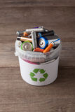 Battery recycle bin with old element on wood table Stock Photography