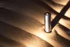 Battery On Sand Royalty Free Stock Photo