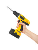 Battery screwdriver in hand Royalty Free Stock Image