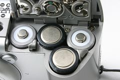 Battery slots in a compact camera.  Royalty Free Stock Image