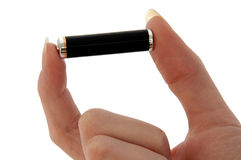 Battery - Small AAA battery, held between fingers Stock Images
