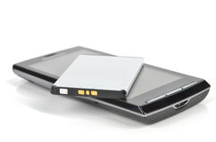 Battery and smart phone Stock Image