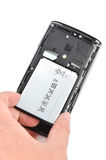 Battery and smart phone Stock Photos