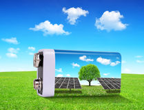 Battery with solar panels in grass. stock photo