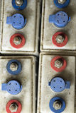 Battery terminals. Abstract pattern of battery terminals on dirty plastic battery cases Stock Photo