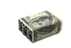 Battery twisted into money Royalty Free Stock Photos