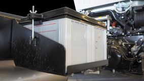 Battery 12 volt 100 amp large size installed of truck Stock Image