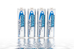 Battery on white. Battery AA on white with reflections Royalty Free Stock Photos