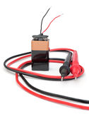 Battery with wires. Royalty Free Stock Photography