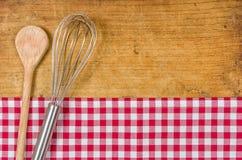 Battez et cuillère en bois Image stock