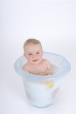 Batthtime. One year old baby is taking a bath (with milk Royalty Free Stock Photos