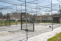 Batting Cages in Park. Chain link batting cages in a public baseball park Stock Image