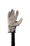Batting glove on a bat. Old and worn out glove on a batting grip. Clipping path included Royalty Free Stock Image