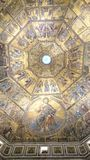 Battistero interior - dome ceiling with golden mosaic icons Stock Photo