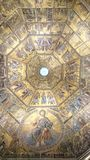 Battistero interior - dome ceiling with golden mosaic icons. Interior details of the gold mosaics that decorate the dome ceiling of the baptistery in Florence Royalty Free Stock Image