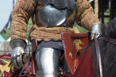 Battle. Medieval knight on horseback at a jousting tournament Stock Photo