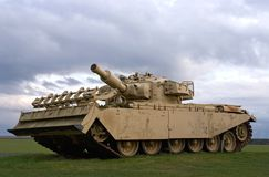 Battle. A tank against a stormy sky royalty free stock images