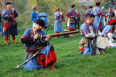 A battle. Participants  of military historical festival Terra heroica play off a battle. 2-5 October 2008 years in town Kamenec-podol'sk in Ukraine passed Royalty Free Stock Photos