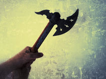 Battle axe. Man holding a battle axe, taken with an iphone 4S using the Snapseed app Royalty Free Stock Photography
