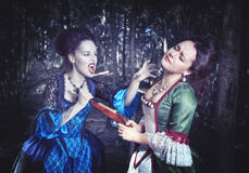Battle with beautiful vampire in medieval dress Royalty Free Stock Image