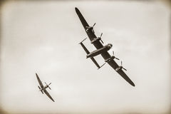 Battle of Britain. Lancaster bomber and Spitfire fighter, part of the Battle of Britain Memorial Flight, reproduced in the style of a vintage war-time photograph Royalty Free Stock Image