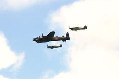 Battle of Britain Memorial Flight. The Battle of Britain Memorial Flight, consisting of a Lancaster bomber escorted by Hurricane and Spitfire fighters, perform Stock Photography