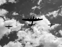 Battle of Britain Memorial Flight. The Battle of Britain Memorial Flight, consisting of a Lancaster bomber flanked by Spitfire and Hurricane fighters, gives a Royalty Free Stock Images