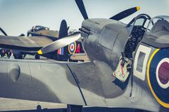 Battle of Britain Spitfire with Lancaster Bomber in background. Supermarine Spitfire from the Battle of Britain Memorial Flight with Avro Lancaster bomber in Royalty Free Stock Photo