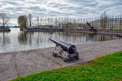 Battle cannon on the waterfront in Kronstadt. Stock Photos