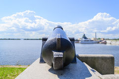 Battle cannon on the waterfront in Kronstadt Royalty Free Stock Photo