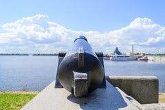 Battle cannon on the waterfront in Kronstadt. Kronstadt, St. Petersburg. Attractions Of Kronstadt. Ancient artillery gun. Gun - monument martial merits of royalty free stock photo