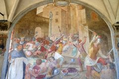 Battle between Catholics and heretics at the time of St. Peter the Martyr, fresco in Santa Maria Novella church, Florence. Battle between Catholics and heretics royalty free stock photos