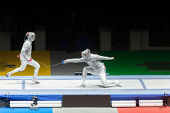 Battle on championship in fencing. Royalty Free Stock Photo