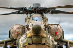 Battle chopper. Details of the russian military helicopter on the ground with sky in background Stock Photo