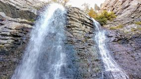 Battle Creek Falls. Cascading down the layers of rock and spraying the rocks below Stock Photography