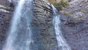 Battle Creek Falls. A shot of Battle Creek Falls cascading down the layered rock wall stock video footage