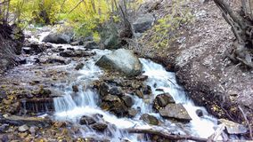 Battle Creek Flowing in Autumn. Battle Creek flowing around the rocks and down the stream bed Stock Images