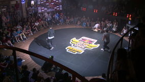 Battle of the dancers on the dance ring in a nightclub. KIEV, UKRAINE - JUNE 28, 2014:Break dance competitions in Kiev Red Bull BC One Cypher stock video footage