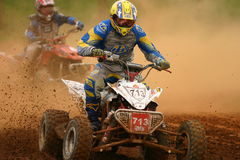 Battle of the dirt. First riders battling for firts position in national event in Puerto Rico Royalty Free Stock Image