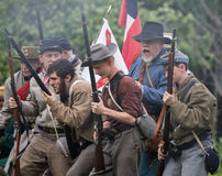 Battle Emotions. Civil War era soldiers in battle at the Dog Island reenactment in Red Bluff, California royalty free stock photo