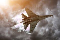 Battle fighter jet flying dives breaking clouds on a thunderstorm sky. Battle fighter jet flying dives breaking clouds on a thunderstorm sky Stock Photos